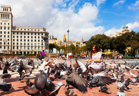 avenues: BARCELONA, SPAIN - SEPTEMBER 12: Doves at Catalonia Square on September 12, 2013 in Barcelona, Spain.  Some of most important streets and avenues meet at here. Center of business and cultural life