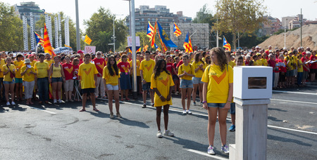 demanding: BARCELONA, SPAIN - SEPTEMBER 11, 2014: Young girls at rally demanding independence for Catalonia in Barcelona, Spain