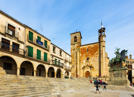 pizarro: TRUJILLO, SPAIN - NOVEMBER 18, 2014:  Church and Equestrian statue of Francisco Pizarro at  Plaza Mayor in autumn. Trujillo, Caceres