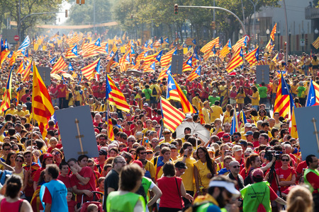 demanding: BARCELONA, SPAIN - SEPTEMBER 11, 2014: People at rally demanding independence for Catalonia (National Day of Catalonia) in Barcelona Editorial