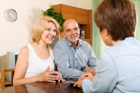 private insurance: Elderly couple discussing details of private insurance with agent
