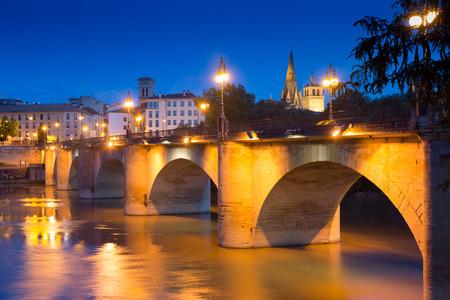 oldest: ancient stone bridge over Ebro  in summer night.  Logrono, La Rioja, Spain