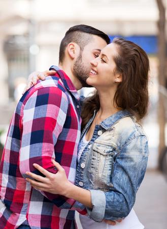 sidewalk talk: Young man meeting his girlfriend at city street