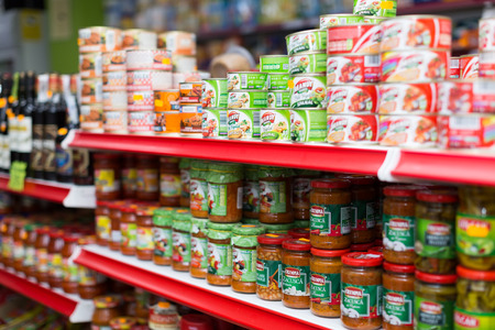 canned goods: BARCELONA, SPAIN - MARCH 22, 2015: Shelves with canned goods at groceries section of average Polish supermarket in Spain. Editorial