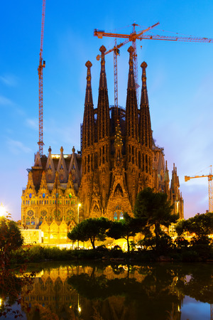 begun: BARCELONA, SPAIN - SEPTEMBER 13, 2014: Sagrada Familia in sunset. Barcelona. Basilica and Expiatory Church of Holy Family by Gaudi, building is begun in 1882