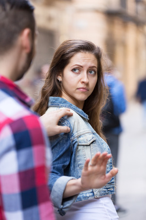 accosting: Young man does not succeed in getting acquainted with beautiful girl Stock Photo