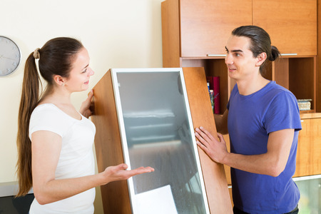 transposition: Activity young couple working at home interior Stock Photo