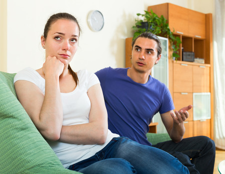 difficulties: Ordinary young family having difficulties at home