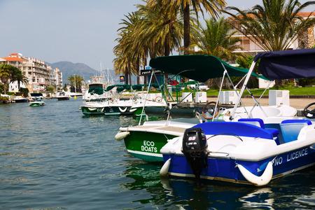 waterways: EMPURIABRAVA, SPAIN - MAY 14, 2015: Boats in canals of Empuriabrava. Empuriabrava  is the largest residential marina in Europe with some 24 km of navigable waterways Editorial