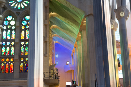 uncomplete: BARCELONA, SPAIN - MARCH 17, 2015: Interior of Sagrada Familia in Barcelona.  Famous Church by Catalan architect Gaudi, building is begun in 1882