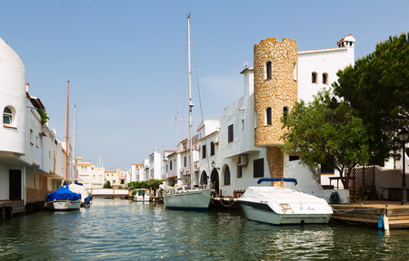 navigable: EMPURIABRAVA, SPAIN - MAY 14, 2015: Canals of Empuriabrava. Empuriabrava  is the largest residential marina in Europe with some 24 km of navigable waterways Editorial