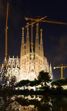 begun: BARCELONA, SPAIN - SEPTEMBER 13, 2014: Sagrada Familia in night. Barcelona, Catalonia.  Famous Church building is begun in 1882