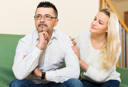 soothe: Loving woman tries reconcile with upset man after quarrel. Focus on guy