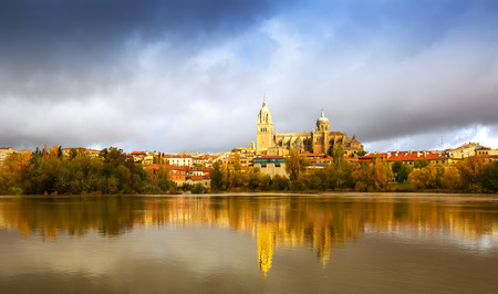 castile: November view of Salamanca with Tormes River and Cathedral. Castile and Leon, Spain
