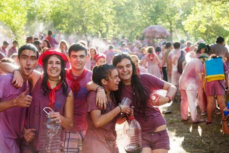vino: HARO, SPAIN - JUNE 29, 2014: Happy wet people during Batalla del vino - Haro Wine Festival, La Rioja. People fighting with wine from botas, bottles and buckets