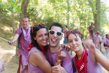 vino: HARO, SPAIN - JUNE 29, 2014: Happy wet people at Haro Wine Festival (Batalla del vino)