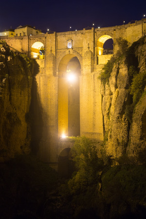 ronda: Medieval bridge in night time.  Ronda, Spain Stock Photo