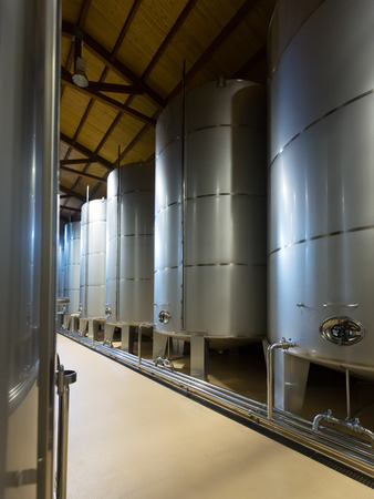 stell: Rows of contemporary stell barrels in winery factory