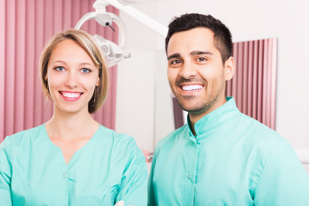 trained nurse: Portrait of professional doctor and assistant at dental clinic Stock Photo
