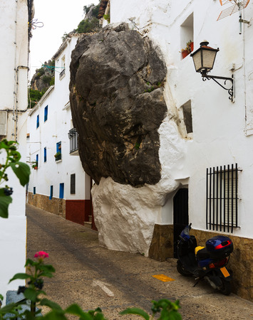 dwelling house: Dwelling  house built with rock inside in spanish town. Ubrique, Spain Stock Photo