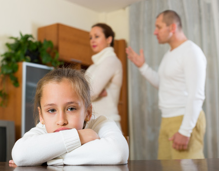 fracas: Parents and daughter quarrel in the home. Focus on girl