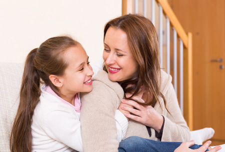 Casual family portrait of happy cheerful mother with smiling daughter photo