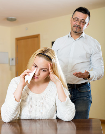 dismay: couple having quarrel at home. Focus on the woman