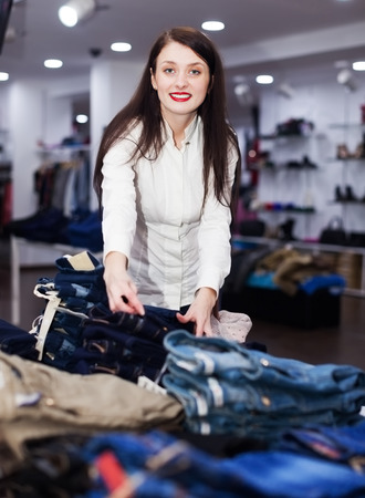hellion: Girl choosing trousers at fashion store
