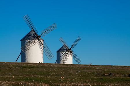 mancha: Two windmills in field. La Mancha, Spain Stock Photo