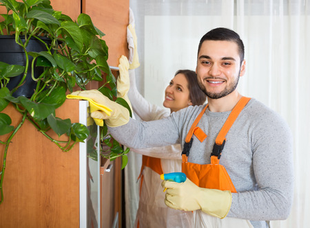 houseman: Positive professional cleaners with equipment working at client house Stock Photo