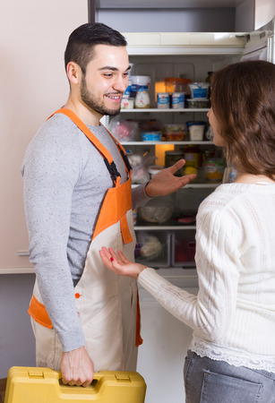 aftersales: Professional workman visiting female customer for after-sales service Stock Photo