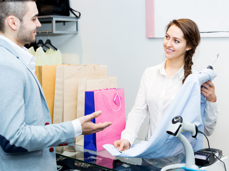 satisfied customer: Happy cashier and satisfied customer at checkout desk