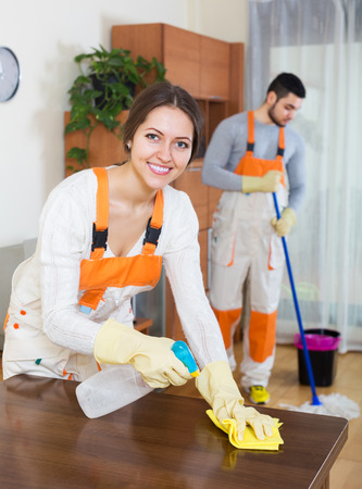 houseman: Portrait of smiling professional cleaners with equipment