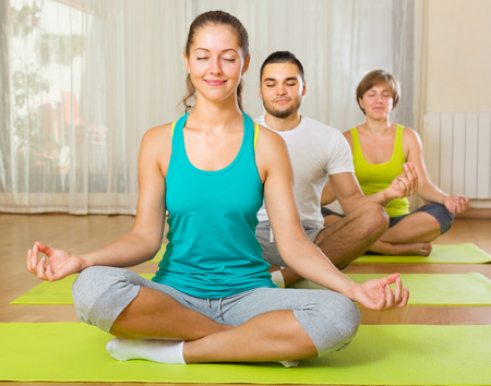 yoga class: happy group having yoga class in sport club Stock Photo