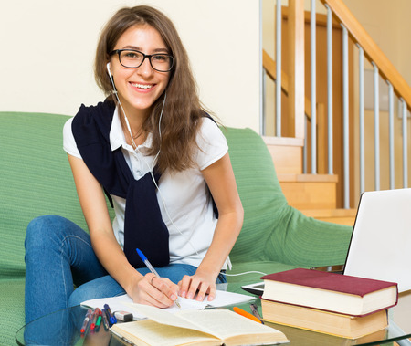 erudition: positive young girl using laptop at home