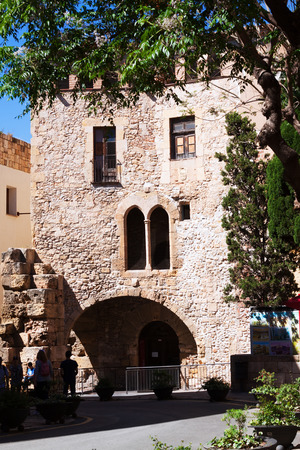 1st century: TARRAGONA, SPAIN - MAY 16, 2015: Plaza del Pallol Square -  Includes the ruins of the Roman forum, which dates from the 1st century AD.  Tarragona. Editorial