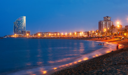View of Barceloneta Beach in summer night in Barcelona, Spain Stock Photo