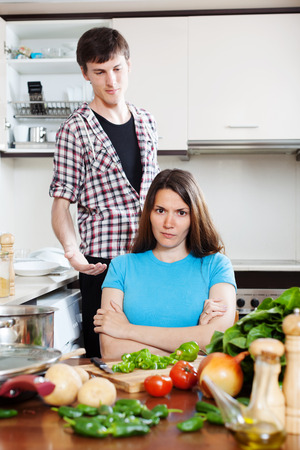 quarrel: Young married couple after quarrel at kitchen Stock Photo