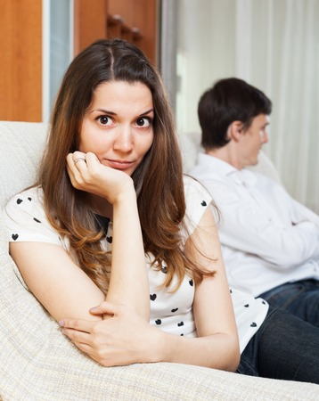 conflicting: Depressed girl conflicting with boyfriend at home Stock Photo