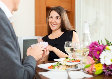 affiance: man giving a box with  ring to girl on date Stock Photo