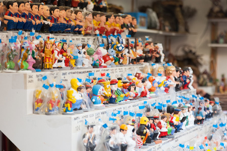 defecation: BARCELONA, SPAIN - DECEMBER 12: Caricature catalan caganers on counter for sale on December 12, 2013 in Barcelona, Spain. Caganer is figurine depicted in the act of defecation