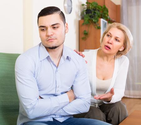mismatch: Quarrel between adult son and senior mature mother at home
