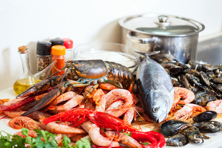 lobster pot: Fresh raw seafoods and fish at cooking table in  kitchen