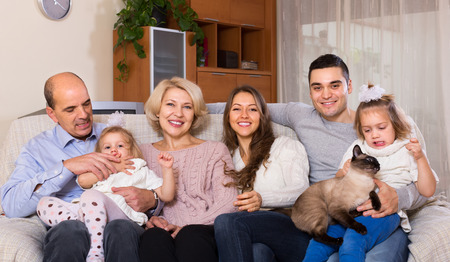 big family: Portrait of big happy multigenerational family on sofa at home Stock Photo