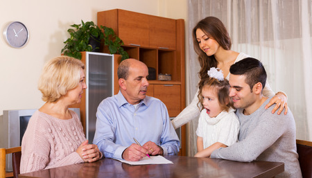 housing problems: serious multigenerational family dealing with housing problems Stock Photo