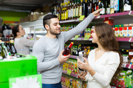 Positive happy customers buying beverages for dinner at food shop photo