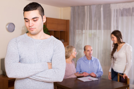 look after: Adult guy with injured look after family quarrel Stock Photo
