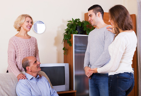 introducing: Adult daughter introducing  boyfriend to parents at home