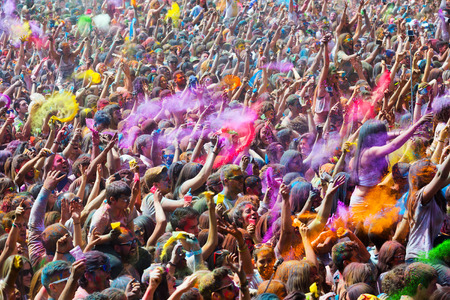 trituration: BARCELONA, SPAIN - APRIL 12, 2015: People during   Festival  Holi at Barcelona. Holi is traditional holiday of India Editorial