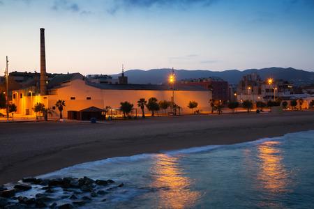 fabrica: City beach in evening time.  Badalona, Spain
